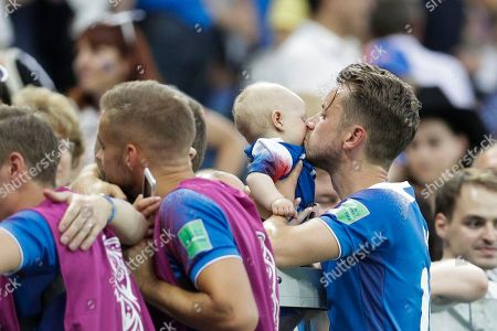 Iceland's Kari Arnason kisses a baby at the end of the group D match between Nigeria and Iceland at the 2018 soccer World Cup in the Volgograd Arena in Volgograd, Russia