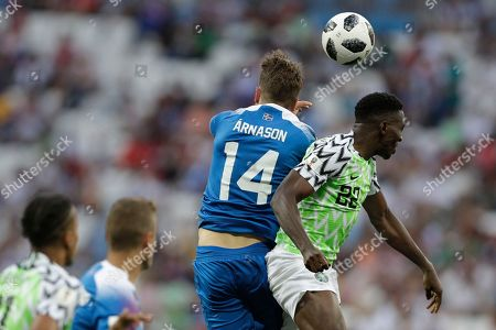 Nigeria's Kenneth Omeruo, right, and Iceland's Kari Arnason challenge for the ball during the group D match between Nigeria and Iceland at the 2018 soccer World Cup in the Volgograd Arena in Volgograd, Russia