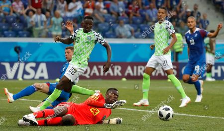 Goalkeeper Francis Uzoho (down) of Nigeria in action during the FIFA World Cup 2018 group D preliminary round soccer match between Nigeria and Iceland in Volgograd, Russia, 22 June 2018. (RESTRICTIONS APPLY: Editorial Use Only, not used in association with any commercial entity - Images must not be used in any form of alert service or push service of any kind including via mobile alert services, downloads to mobile devices or MMS messaging - Images must appear as still images and must not emulate match action video footage - No alteration is made to, and no text or image is superimposed over, any published image which: (a) intentionally obscures or removes a sponsor identification image; or (b) adds or overlays the commercial identification of any third party which is not officially associated with the FIFA World Cup)