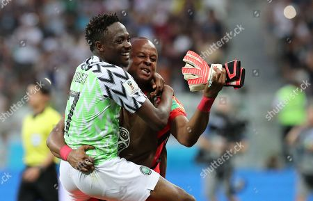 Ahmed Musa of Nigeria and Goalkeeper Ikechukwu Ezenwa of Nigeria