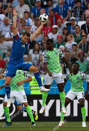 Kari Arnason (L) of Iceland and Bryan Idowu of Nigeria in action during the FIFA World Cup 2018 group D preliminary round soccer match between Nigeria and Iceland in Volgograd, Russia, 22 June 2018. (RESTRICTIONS APPLY: Editorial Use Only, not used in association with any commercial entity - Images must not be used in any form of alert service or push service of any kind including via mobile alert services, downloads to mobile devices or MMS messaging - Images must appear as still images and must not emulate match action video footage - No alteration is made to, and no text or image is superimposed over, any published image which: (a) intentionally obscures or removes a sponsor identification image; or (b) adds or overlays the commercial identification of any third party which is not officially associated with the FIFA World Cup)