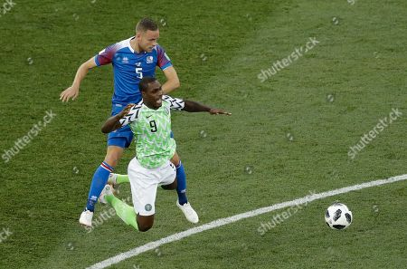 Nigeria's Odion Ighalo, right, fights for the ball with Iceland's Sverrir Ingason during the group D match between Nigeria and Iceland at the 2018 soccer World Cup in the Volgograd Arena in Volgograd, Russia