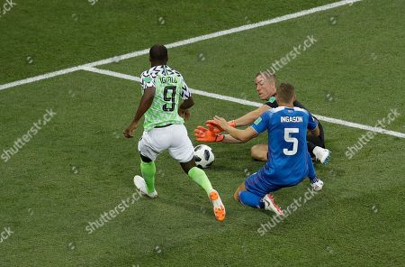 Iceland goalkeeper Hannes Halldorsson makes a save in front of Nigeria's Odion Ighalo during the group D match between Nigeria and Iceland at the 2018 soccer World Cup in the Volgograd Arena in Volgograd, Russia