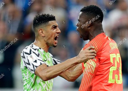 Nigeria's Leon Balogun, left, and Nigeria goalkeeper Francis Uzoho react after Iceland's Gylfi Sigurdsson missed a penalty kick during the group D match between Nigeria and Iceland at the 2018 soccer World Cup in the Volgograd Arena in Volgograd, Russia