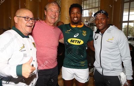 Stock Picture of Charles Wessels Operational Head of South Africa with Rob Louw former South African rugby player Sikhumbuzo Notshe of South Africa and JJ Fredericks (Logistics Manager) duringthe South African Springbok team photo,  at the The Cullinan Hotel in Cape Town.South Africa. 22,06,2018 22,06,2018 Photo by (Steve Haag JMP)
