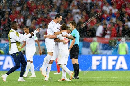 (L-R) Switzerland's soccer goalkeeper Yvon Landry Mvogo and players Blerim Dzemaili, Xherdan Shaqiri and Valon Behrami celebrate the victory during the FIFA World Cup 2018 group E preliminary round soccer match between Switzerland and Serbia at the Arena Baltika Stadium in Kaliningrad, Russia, 22 June 2018.