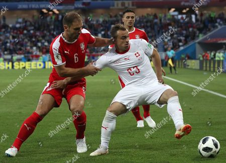 Branislav Ivanovic of Serbia and Xherdan Shaqiri of Switzerland in action during the FIFA World Cup 2018 group E preliminary round soccer match between Serbia and Switzerland in Kaliningrad, Russia, 22 June 2018. (RESTRICTIONS APPLY: Editorial Use Only, not used in association with any commercial entity - Images must not be used in any form of alert service or push service of any kind including via mobile alert services, downloads to mobile devices or MMS messaging - Images must appear as still images and must not emulate match action video footage - No alteration is made to, and no text or image is superimposed over, any published image which: (a) intentionally obscures or removes a sponsor identification image; or (b) adds or overlays the commercial identification of any third party which is not officially associated with the FIFA World Cup)