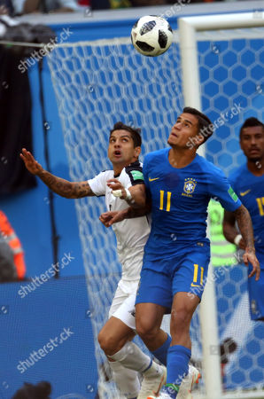 Cristian Gamboa and Coutinho in action during the Fifa World Cup Russia 2018, Group E, football match between Brazil v Costa Rica, Saint Petersburg Stadium.