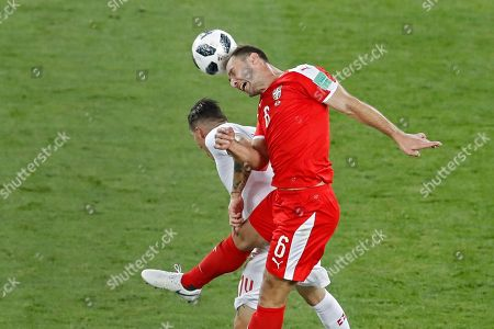Serbia's Branislav Ivanovic, top, out jumps Switzerland's Steven Zuber during the group E match between Switzerland and Serbia at the 2018 soccer World Cup in the Kaliningrad Stadium in Kaliningrad, Russia