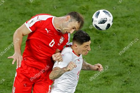 Serbia's Branislav Ivanovic, left, vies for a high ball with Switzerland's Blerim Dzemaili during the group E match between Switzerland and Serbia at the 2018 soccer World Cup in the Kaliningrad Stadium in Kaliningrad, Russia