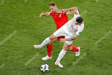 Serbia's Branislav Ivanovic, left, vies for a ball with Switzerland's Steven Zuber during the group E match between Switzerland and Serbia at the 2018 soccer World Cup in the Kaliningrad Stadium in Kaliningrad, Russia