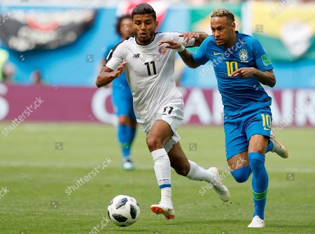 Brazil's Neymar takes the ball past Costa Rica's Johan Venegas, left, during the group E match between Brazil and Costa Rica at the 2018 soccer World Cup in the St. Petersburg Stadium in St. Petersburg, Russia