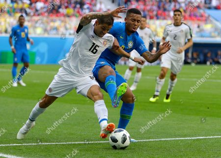 Costa Rica's Cristian Gamboa, left, and Brazil's Gabriel Jesus battle for the ball during the group E match between Brazil and Costa Rica at the 2018 soccer World Cup in the St. Petersburg Stadium in St. Petersburg, Russia