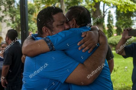 Oscar Garcia (R), hugs his son, Wilder Garcia (L), who was held for 11 days in the El Chipote prison until his release today, in the back garden of the Metropolitan Cathedral of Managua, Nicaragua, 22 June 2018.  A total of 15 people were released in Nicaragua with the mediation of the Catholic Church after being arrested the during protests against the government of Daniel Ortega. Two months of protests have left at least 212 people dead.
