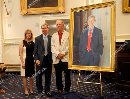 """Former New Hampshire Gov. John Lynch, center poses with his wife, Dr. Susan Lynch, and artist Ralph """"Stoney"""" Jacobs, during the unveiling of his official portrait in Concord, N.H., . Lynch, a Democrat, was elected in 2004 and served four terms"""