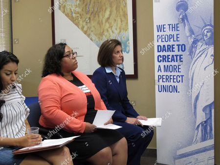 Sen. Catherine Cortez Masto, D-Nev.,(right) waits to speaks at a news conference condemning the Trump administration's immigration policy at the office of the American Civil Liberties of Nevada in Reno, Nev. Daysi Rodriquez, left, outreach coordinator for Tu Casa Latina, and Laura Martin (center), associate director of the Progressive Leadership Alliance of Nevada's political action committee, also delivered remarks