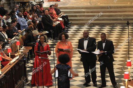 Nadine Benjamin, Gweneth-Ann Rand, Ronald Samm,and Byron Jackson sing The Anthem.