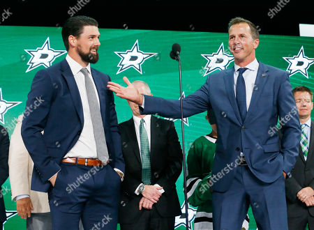 Dallas Stars forward Jamie Benn, left, and retired Dallas Star Mike Modano stand on stage during the NHL hockey draft in Dallas