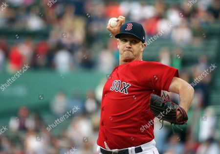 Boston Red Sox starting pitcher Steven Wright delivers to the Seattle Mariners during the first inning of a baseball game at Fenway Park, in Boston