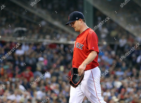 Boston Red Sox starting pitcher Steven Wright walks to the dugout after being taken out during the fourth inning of the team's baseball game against the Seattle Mariners at Fenway Park, in Boston
