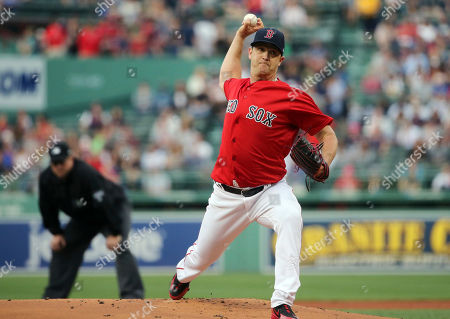 Boston Red Sox starting pitcher Steven Wright delivers to the Seattle Mariners in the first inning of a baseball game at Fenway Park, in Boston