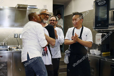 Chef Massimo Bottura coming back from Bilbao where at the World's 50 Best Restaurants 2018 the restaurant Osteria Francescana was elected for the second time Best restaurant in the world, celebrates with the staff