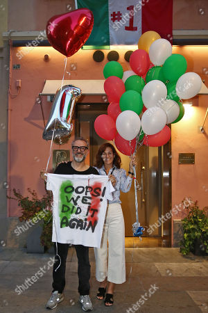 Stock Image of Chef Massimo Bottura with wife Lara Gilmore coming back from Bilbao where at the World's 50 Best Restaurants 2018 the restaurant Osteria Francescana was elected for the second time Best restaurant in the world, celebrated in front of their restaurant