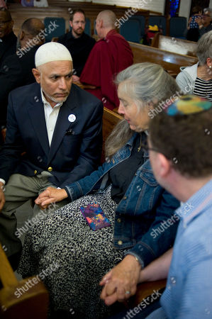 Imam Shakeel Syed listens to Reverend Bonnie Tarweter as she shares an experience with him and Rabbi Benjamin Ross at the Our Lady of Mount Carmel Catholic church during an interfaith prayer service in San Diego, California, USA, 22 June 2018. The gathering was organized in support of undocumented families who have been separated after crossing the U.S.-Mexico border. Clergy and other supporters will hold a large march and rally on Saturday  in support of separated families at the Otay Mesa Detention Center. (David Maung/European Pressphoto Agency)