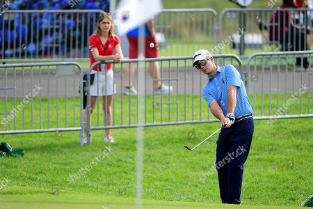 Kevin Streelman of the United States works on his chips shot at the practice green during the first day of game play at the PGA Travelers Championship golf tournament