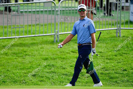 Kevin Streelman of the United States walks to a practice bunker during the first day of game play at the PGA Travelers Championship golf tournament