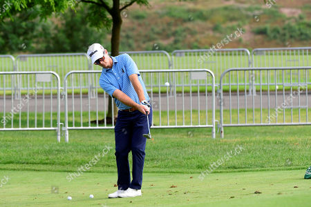 Kevin Streelman of the United States works on his chipping during the first day of game play at the PGA Travelers Championship golf tournament