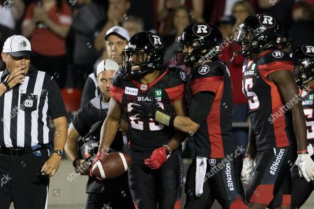 Ottawa Redblacks running back William Powell (29) celebrates with teammates after scoring a touchdown during the CFL game between the Saskatchewan Roughriders and Ottawa Redblacks at TD Place Stadium in Ottawa, Canada. Redblacks won by a score of 40-17