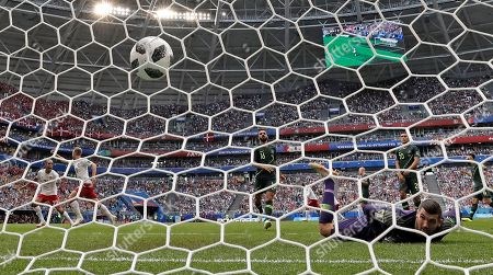Denmark's Christian Eriksen scores his side's opening goal past Australia goalkeeper Mathew Ryan during the group C match between Denmark and Australia at the 2018 soccer World Cup in the Samara Arena in Samara, Russia
