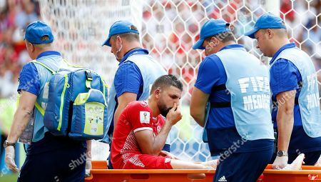 Syam Ben Youssef of Tunisia is brought off the pitch on a stretcher during the FIFA World Cup 2018 group G preliminary round soccer match between Belgium and Tunisia in Moscow, Russia, 23 June 2018. (RESTRICTIONS APPLY: Editorial Use Only, not used in association with any commercial entity - Images must not be used in any form of alert service or push service of any kind including via mobile alert services, downloads to mobile devices or MMS messaging - Images must appear as still images and must not emulate match action video footage - No alteration is made to, and no text or image is superimposed over, any published image which: (a) intentionally obscures or removes a sponsor identification image; or (b) adds or overlays the commercial identification of any third party which is not officially associated with the FIFA World Cup)