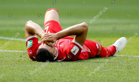 Syam Ben Youssef of Tunisia reacts in pain during the FIFA World Cup 2018 group G preliminary round soccer match between Belgium and Tunisia in Moscow, Russia, 23 June 2018. (RESTRICTIONS APPLY: Editorial Use Only, not used in association with any commercial entity - Images must not be used in any form of alert service or push service of any kind including via mobile alert services, downloads to mobile devices or MMS messaging - Images must appear as still images and must not emulate match action video footage - No alteration is made to, and no text or image is superimposed over, any published image which: (a) intentionally obscures or removes a sponsor identification image; or (b) adds or overlays the commercial identification of any third party which is not officially associated with the FIFA World Cup)