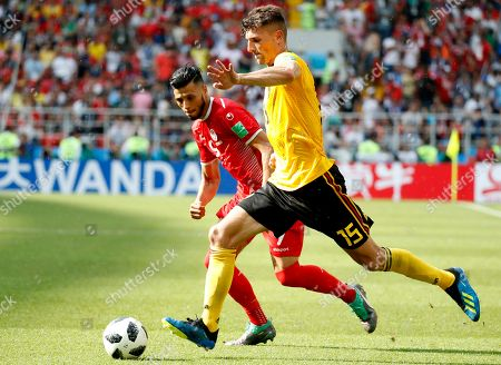 Anice Badri (L) of Tunisia and Thomas Meunier of Belgium in action during the FIFA World Cup 2018 group G preliminary round soccer match between Belgium and Tunisia in Moscow, Russia, 23 June 2018. (RESTRICTIONS APPLY: Editorial Use Only, not used in association with any commercial entity - Images must not be used in any form of alert service or push service of any kind including via mobile alert services, downloads to mobile devices or MMS messaging - Images must appear as still images and must not emulate match action video footage - No alteration is made to, and no text or image is superimposed over, any published image which: (a) intentionally obscures or removes a sponsor identification image; or (b) adds or overlays the commercial identification of any third party which is not officially associated with the FIFA World Cup)