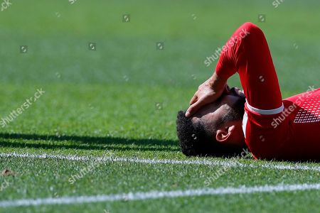 Tunisia's Dylan Bronn lies on the pitch during the group G match between Belgium and Tunisia at the 2018 soccer World Cup in the Spartak Stadium in Moscow, Russia