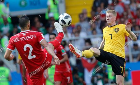 Kevin De Bruyne, Syam Ben Youssef. Belgium's Kevin De Bruyne, right, and Tunisia's Syam Ben Youssef challenge the ball during the group G match between Belgium and Tunisia at the 2018 soccer World Cup in the Spartak Stadium in Moscow, Russia