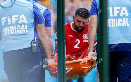 Tunisia's Syam Ben Youssef is carried from the pitch after getting injured during the group G match between Belgium and Tunisia at the 2018 soccer World Cup in the Spartak Stadium in Moscow, Russia