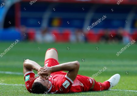 Tunisia's Syam Ben Youssef lies on the pitch after getting injured during the group G match between Belgium and Tunisia at the 2018 soccer World Cup in the Spartak Stadium in Moscow, Russia