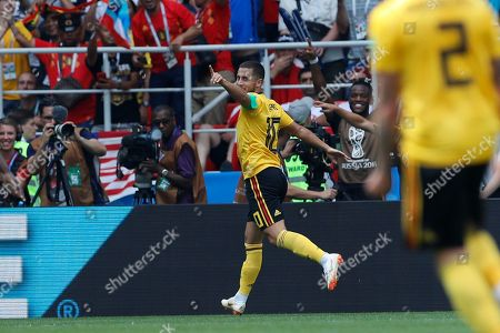 Belgium's Eden Hazard, center, celebrates after scoring their side's forth goal past Tunisia goalkeeper Farouk Ben Mustapha during the group G match between Belgium and Tunisia at the 2018 soccer World Cup in the Spartak Stadium in Moscow, Russia