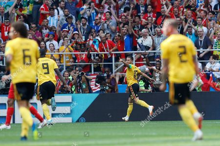 Belgium's Eden Hazard, center, celebrates after scoring their side's fourth goal past Tunisia goalkeeper Farouk Ben Mustapha during the group G match between Belgium and Tunisia at the 2018 soccer World Cup in the Spartak Stadium in Moscow, Russia