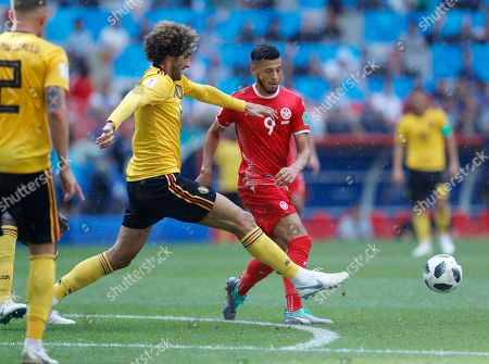 Marouane Fellaini, Anice Badri. Belgium's Marouane Fellaini, center, and Tunisia's Anice Badri, right, challenge for the ball during the group G match between Belgium and Tunisia at the 2018 soccer World Cup in the Spartak Stadium in Moscow, Russia
