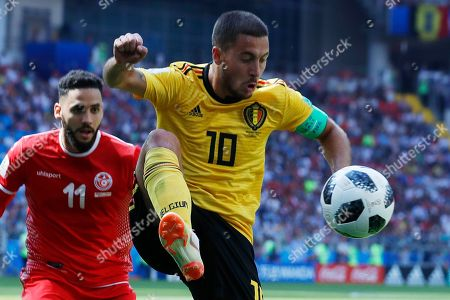 Eden Hazard, Dylan Bronn. Belgium's Eden Hazard, right, and Tunisia's Dylan Bronn challenge for the ball during the group G match between Belgium and Tunisia at the 2018 soccer World Cup in the Spartak Stadium in Moscow, Russia