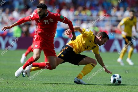 Jan Vertonghen, Dylan Bronn. Belgium's Jan Vertonghen, right, and Tunisia's Dylan Bronn challenge for the ball during the group G match between Belgium and Tunisia at the 2018 soccer World Cup in the Spartak Stadium in Moscow, Russia