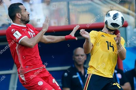Dries Mertens, Ali Maaloul. Belgium's Dries Mertens, right, and Tunisia's Ali Maaloul challenge for the ball during the group G match between Belgium and Tunisia at the 2018 soccer World Cup in the Spartak Stadium in Moscow, Russia