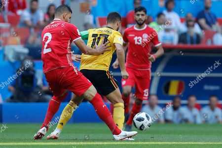 Eden Hazard, Syam Ben Youssef. Belgium's Eden Hazard, center, and Tunisia's Syam Ben Youssef, left, challenge for the ball during the group G match between Belgium and Tunisia at the 2018 soccer World Cup in the Spartak Stadium in Moscow, Russia
