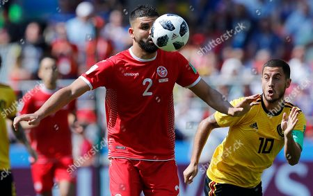 Syam Ben Youssef, Eden Hazard. Tunisia's Syam Ben Youssef, center, and Belgium's Eden Hazard, right, challenge for the ball during the group G match between Belgium and Tunisia at the 2018 soccer World Cup in the Spartak Stadium in Moscow, Russia