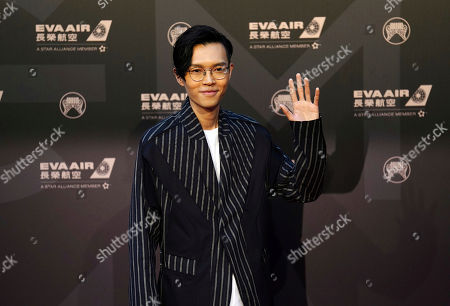 Hong Kong singer Khalil Fong smiles as he arrives at the 29th Golden Melody Awards in Taipei, Taiwan, . Fong is a guest at this year's Golden Melody Awards, one of the world's biggest Chinese-language pop music annual events