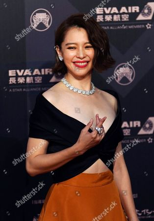 Stock Photo of Taiwanese singer Vivian Hsu smiles as she arrives at the 29th Golden Melody Awards in Taipei, Taiwan, . Hsu is a guest at this year's Golden Melody Awards, one of the world's biggest Chinese-language pop music annual events